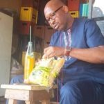 Photos Of Hon Patrick Obahiangbon Munching Loaf Of Bread By The Road Side In Edo State
