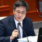South Korea's Moon Jae-in sacks finance minister, policy chief