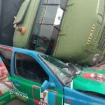 Truck Falls On Branded APC Car In Owerri, Driver In Critical Condition