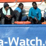 Italy lets 10 stranded migrants disembark but moves to ban rescue ships from its waters