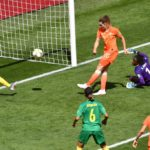 The Netherlands beat Cameroon beat 3-1 securing their place in the knockout stages