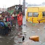 Students Spotted Struggling To Walk Home On A Flooded Lagos Street