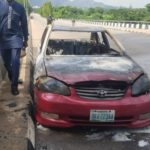 Photos: Shiites protesters burn, vandalise vehicles at NASS