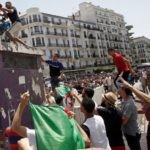 Algerian protesters push for reforms, as man attempts to set self ablaze