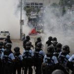 Hong Kong protests: Police arrest 65, youngest aged 12