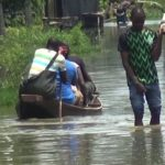 Residents use canoes as flood takes over Lagos community