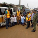 VIDEO & PHOTOS: Parents Of Children Caught On Camera Throwing Refuse In Drainage Channel Arrested In Lagos