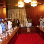 Photos Of President Buhari Signing The 2020 Budget Into Law