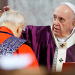 Pope appears in public ill, cancels planned retreat