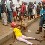 Lady Dumped At A Junction In Port Harcourt With Money Inside Her Handbag (Photos)