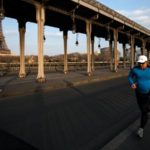 Paris bans daytime jogging as virus deaths hit new high