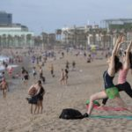 Spain eases Covid-19 lockdown in Madrid, Barcelona and reopens beaches