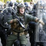 Trump threatens to deploy military as peaceful rally tear-gassed