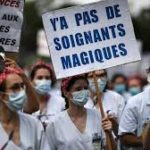 Enough applause: French health workers rally anew for post-coronavirus reforms