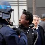 French police discriminate against black and Arab men, rights group says
