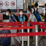 Chinese county restricts travel as Beijing races to contain virus