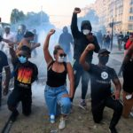 Paris police unleash tear gas as rioters spark fires, hurl debris