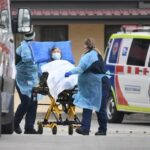 Australia posts daily virus record, more deaths expected