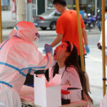 China reports virus spike as global cases pass 16 million