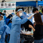 South Korea reports Covid-19 spike, virus-wracked US states tighten controls