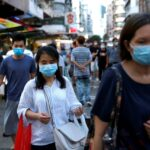 Hong Kong tightens coronavirus restrictions as new cases spike