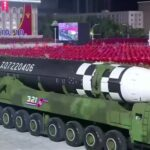 North Korea displays new intercontinental ballistic missile at military parade (photos)