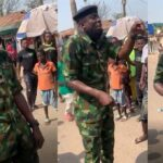 Moment a Soldier calmly advised a mob against looting food at NYSC camp meant for corp members (Video)