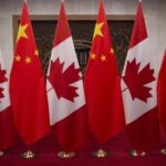 Two Canadians detained in China allowed calls with relatives
