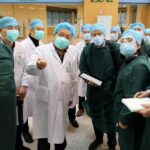 China says WHO experts to probe Covid-19 origins during long-awaited mission