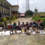 Police parade manufacturer of explosive device, eight others; recover assorted arms