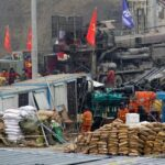 China starts to recover miners trapped for 14 days after underground explosion