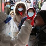 China Locks Down A City Of 11 Million People To Contain A Coronavirus Flare-Up