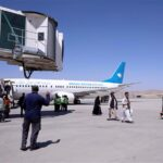 Taliban stop planes with hundreds of evacuees from leaving but it's unclear why