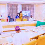 Photos: Buhari Swears In Three INEC National Commissioners