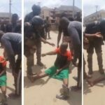 Old Woman Pushes Back At Security Operatives Trying To Take Her Away For Wearing A Biafran Outfit (Video)